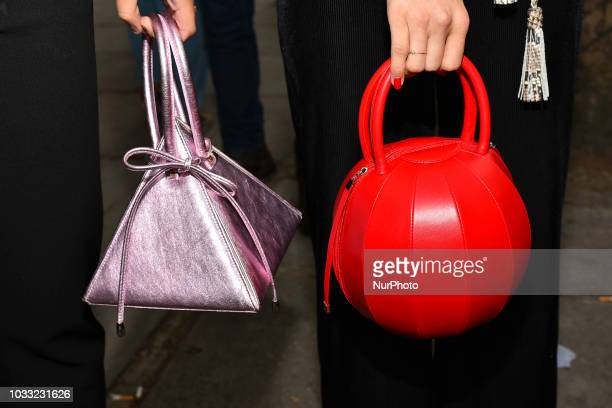 People showcase street style outfits accessories and details outside the BFC Showspace at the Strand during London Fashion Week September 2018 London...