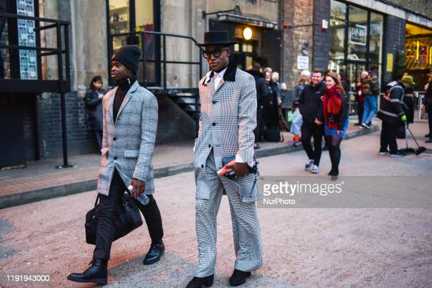 People showcase their outfit during London Fashion Week Men's January 2020 on January 5 2020 in London England