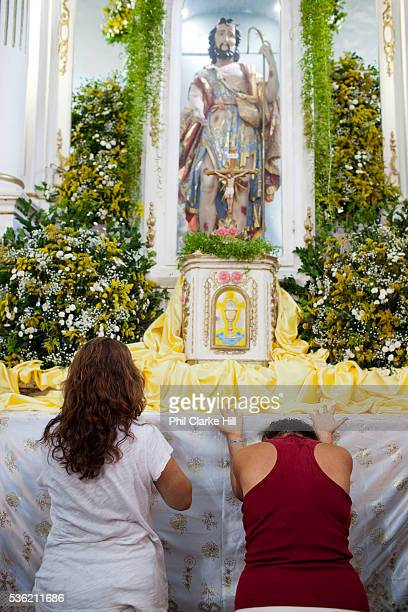 People showing their devotion to Sao Lazaro at an altar Often the lines between Candomble and Catholicism are blurred This is especially true with...