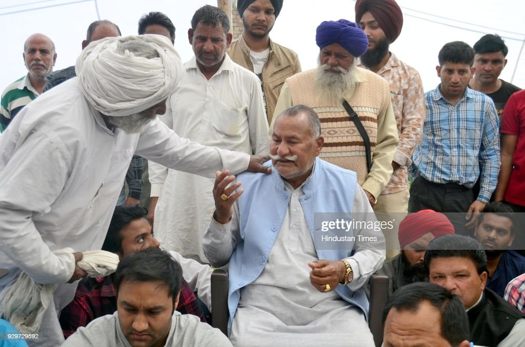 People showing their grief with Sufi Singer Padma Shri Ustad Puran Chand Wadali after his younger brother Ustad Pyarelal Wadali death at his native...