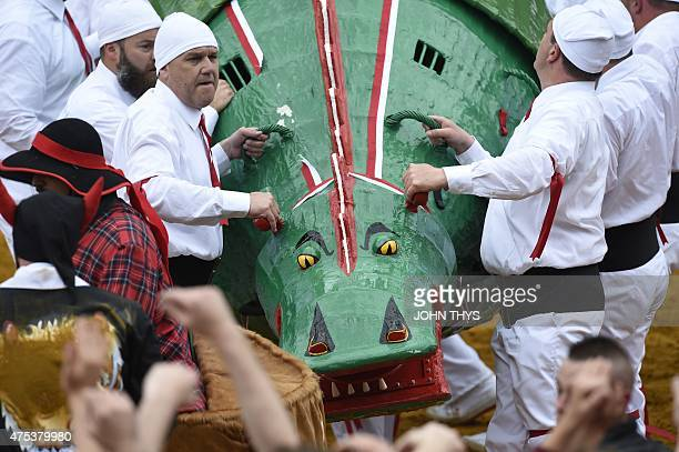 People shows the dragon during the Ducasse Doudou folkloric festival in Mons on May 31 2015 The Doudou feast compromises two parts a procession with...
