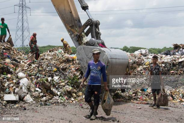 People sift through mountains of rubbish searching for anything reusable or recyclable they can sell although it will earn them less than $3 a day...