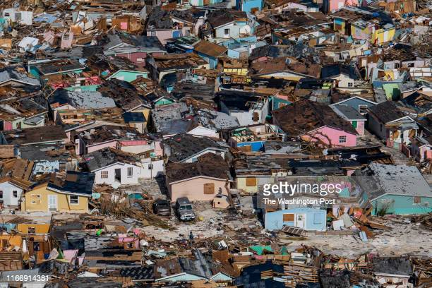 People sift through the destruction left by Hurricane Dorian in the Mudd neighborhood of Marsh Harbour, Bahamas on September 7, 2019. The storm made...