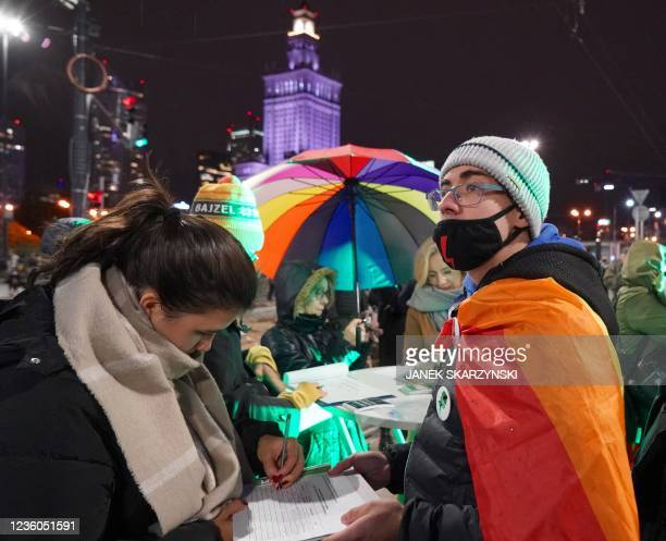 People sign a petition during a demonstration demanding the restoring of the right to abortion in Poland on October 22, 2021 in Warsaw, marking the...