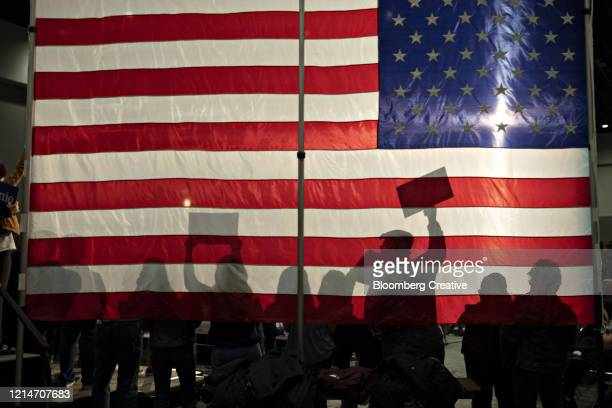 people silhouetted against an american flag - politics abstract stock pictures, royalty-free photos & images