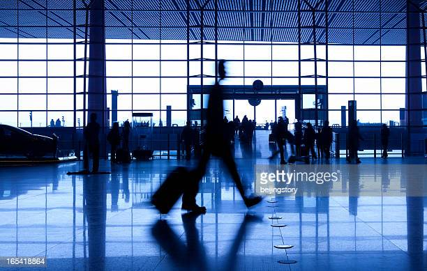 people silhouettes at airport building - global entry stock pictures, royalty-free photos & images