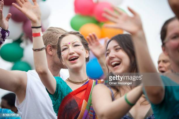 People sing and dance in a line during a Hare Krishna celebration at the 2017 Woodstock Festival Poland on August 4 2017 in Kostrzyn Poland The...