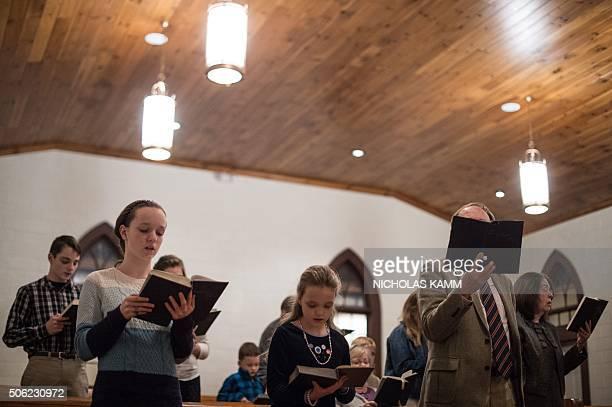 People sing hymns at Grace Orthodox Presbyterian Church during a Sunday evening service in Lynchburg Virginia on January 17 2016 The young...