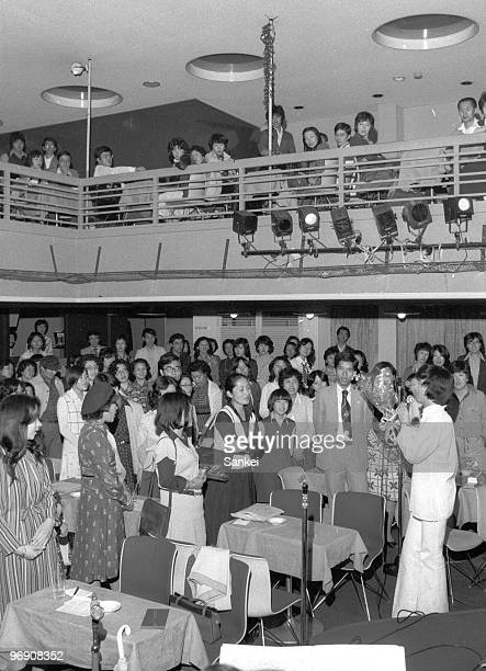 People sing songs at Utagoe Kissa or Singing Cafe Tomoshibi on October 8 1977 in Tokyo Japan