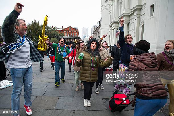 People sing songs in the French Quarter during Mardi Gras February 17 2015 in New Orleans Louisiana Mardi Gras or Fat Tuesday is a celebration...