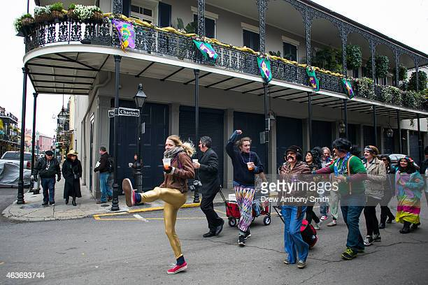 People sing songs while walking through the French Quarter during Mardi Gras February 17 2015 in New Orleans Louisiana Mardi Gras or Fat Tuesday is a...