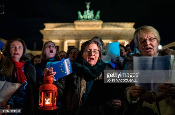 """People sing the EU anthem """"Ode to Joy"""" at midnight during a flashmob to mark Brexit in front of Berlin's Brandenburg Gate on January 31, 2020. -..."""