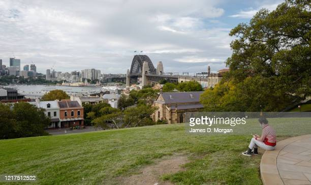 People sit alone at Observatory Hill during the COVID19 pandemic on April 09 2020 in Sydney Australia