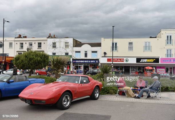 People sit and have a picnic by their Chevrolet Corvette C3 during the Southend Classic Car Show along the seafront on June 17 2018 in Southend on...