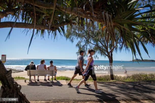 People sit and walk on the Esplanade at Mooloolaba Beach in Mooloolaba, Australia, on Saturday, May 2, 2020. Australia's Prime MinisterScott...