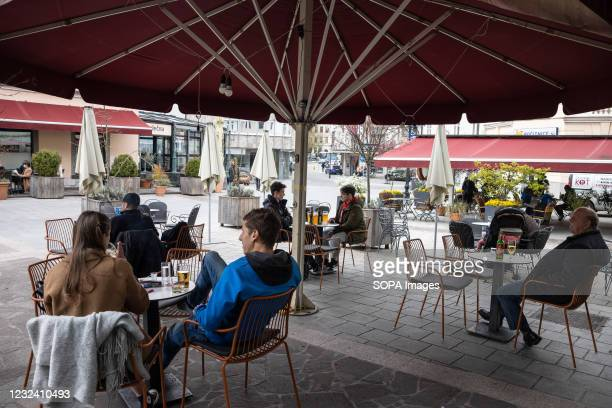 People sit at a bar terrace in Kranj, following the reopening of terraces after several months of lockdown. As Slovenia, reports a gradual decrease...