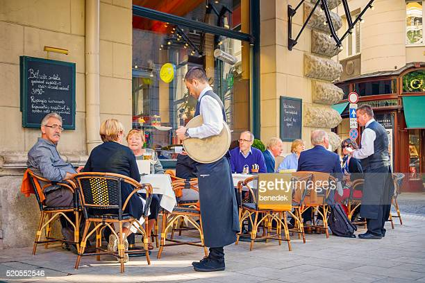 People sit at a Cafe Restaurant in Downtown Budapest Hungary