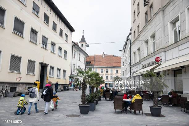 People sit at a cafe terrace in Kranj, following the reopening of terraces after several months of lockdown. As Slovenia, reports a gradual decrease...