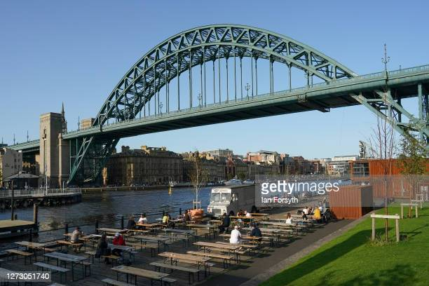 People sit at an open air pub next to the River Tyne on September 17 2020 in Newcastle upon Tyne England Almost two million people in northeast...