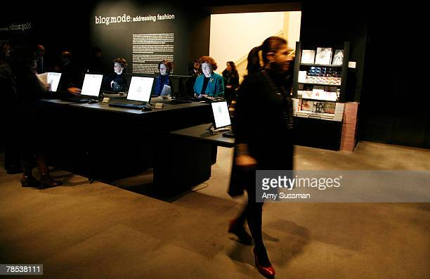 People sit at computers at the Blogmode addressing fashion exhibit at the Metropolitan Museum of Art's Costume Institute on December 17 2007 in New...
