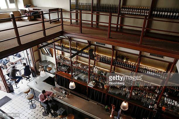 People sit at Osterman barrestaurant once used as a fabric store in the Agia Irini disrict of Athens Greece on Saturday April 25 2015 The downturn...