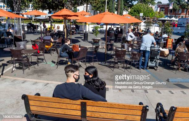 People sit at the outside dining area at the Orange Circle at Glassell Street and Chapman Avenue in Orange, CA on Tuesday, March 9, 2021. Orange...