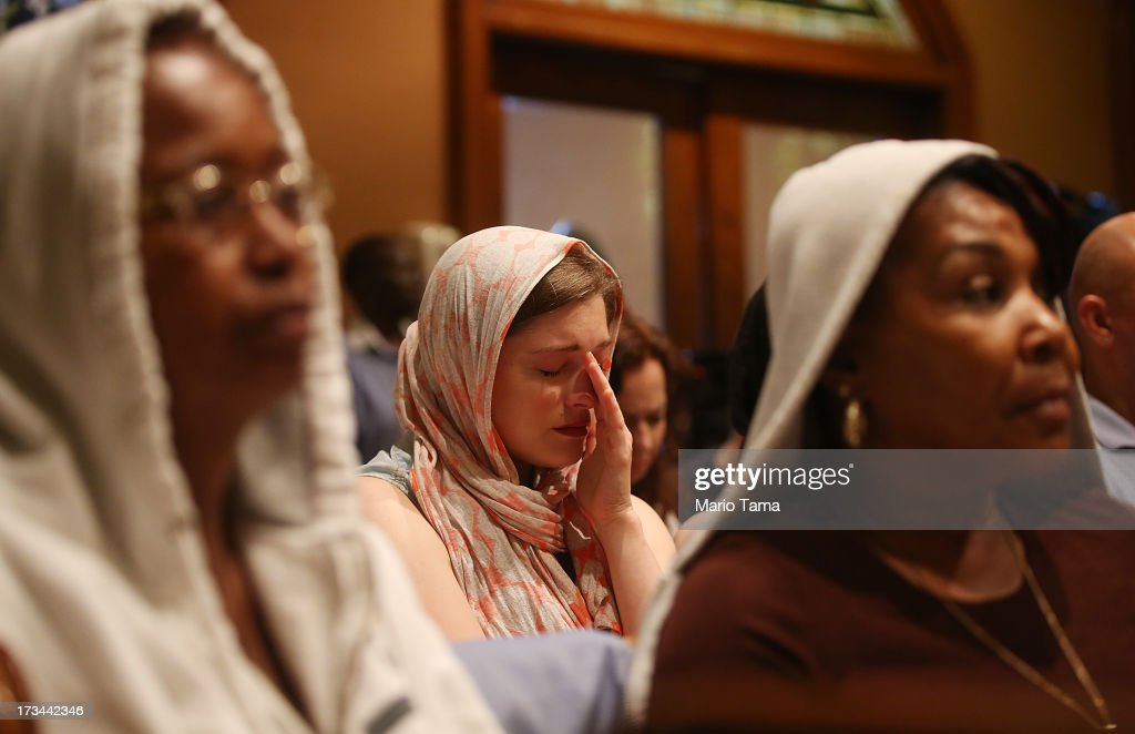 People sit during services honoring Trayvon Martin at Middle Collegiate Church in Manhattan on July 14, 2013 in New York City. George Zimmerman was acquitted of all charges in the shooting death of Martin July 13 and some congregants wore hoodies during the service to honor Martin.