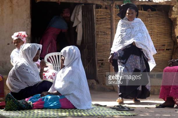 People sit during the funerals of a victim of an attack by armed men in the Bayotte forest in the regional capital Ziguinchor southern Senegal on...