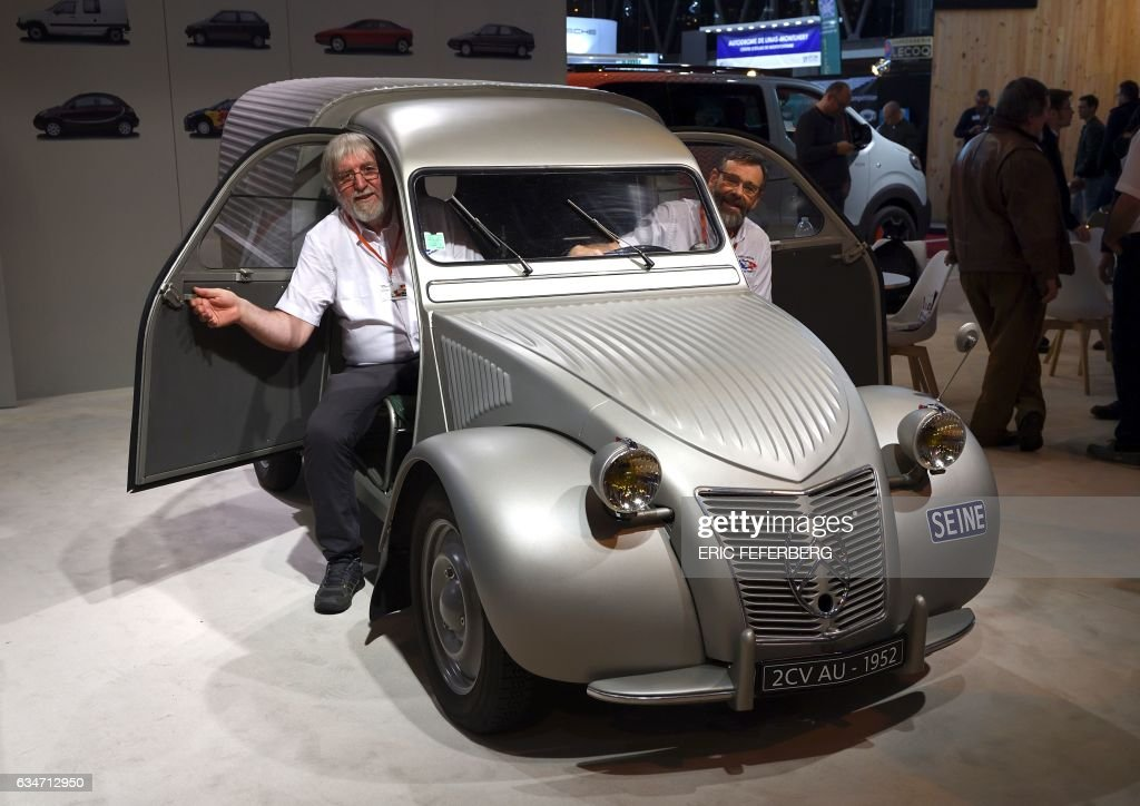 People sit in a 1952 2CV AU during the \'Retromobile\' old cars fair ...