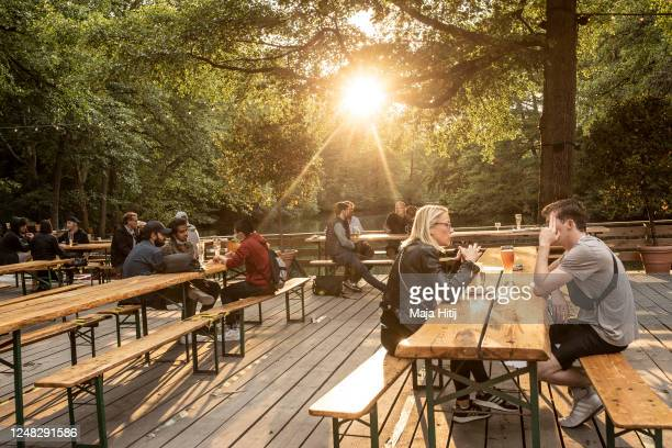 People sit in a beer garden during the novel coronavirus crisis on June 08 2020 in Berlin Germany Most restrictions on public life that had been...