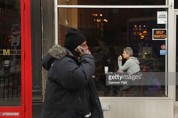 People sit in a cafe in the Fort Greene neighborhood where the director and artist Spike Lee once lived on February 27, 2014 in the Brooklyn borough...