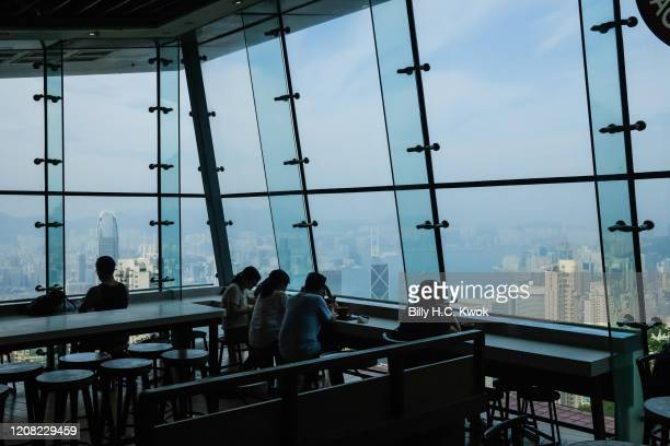 People sit in a cafe viewing the harbour view during a coronavirus outbreak on March 26 2020 in Hong Kong China Latest statistics showed Hong Kong...