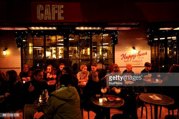 People sit in a coffee shop in Paris France on November 24 2017