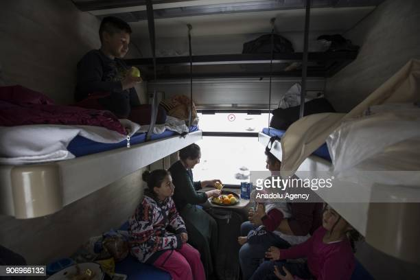 People sit in a compartment of the Eastern Express which travels from Ankara to Kars in Kars Turkey on January 13 2018 With the starting of winter...