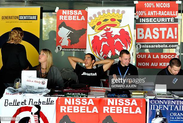 People sit in a stand at the opening of a two-day convention of the French far-right organization Bloc Identitaire , on November 3, 2012 at the...