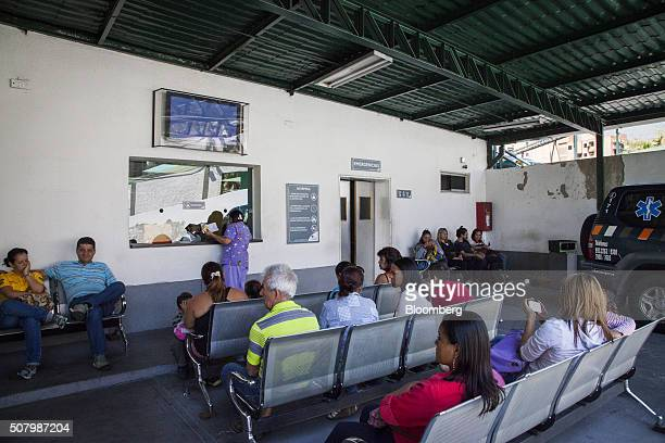 People sit in a waiting room at a public health clinic in the Chacao municipality of Caracas Venezuela on Monday Feb 1 2016 The Zika virus is...