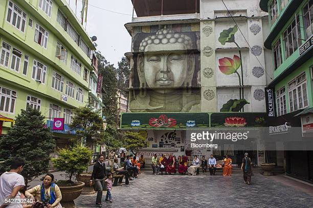 People sit in an outdoor plaza in Gangtok Sikkim India on Monday May 2 2016 Yearonyear growth in Asia's thirdlargest economy accelerated in the first...