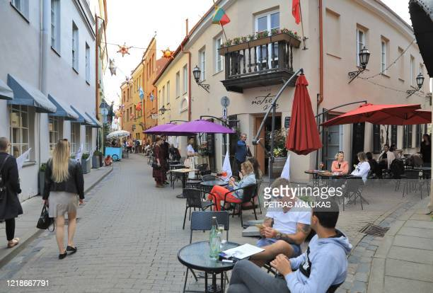 People sit in cafes during a tourism event to mimicking the Italian holiday experience in Vilnius, Lithuania on June 6, 2020. - With virus travel...