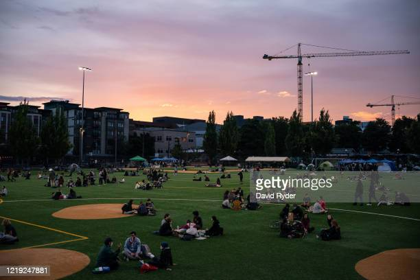 "People sit in Cal Anderson Park in the so-called ""Capitol Hill Autonomous Zone"" on June 10, 2020 in Seattle, Washington. The zone includes the blocks..."