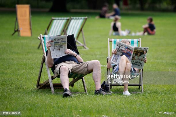 People sit in deck chairs as they enjoy the sunshine in St James's Park in central London on June 7, 2021. - The Delta variant of the coronavirus,...