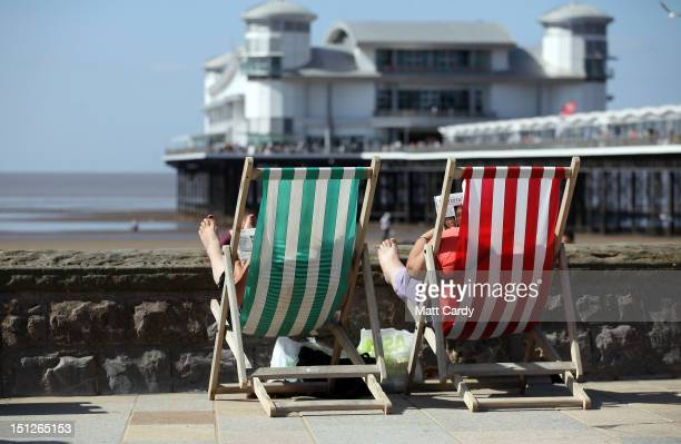 People sit in deckchairs as they enjoy the September weather on the beach at WestonSuperMare on September 5 2012 in Somerset England Many seaside...