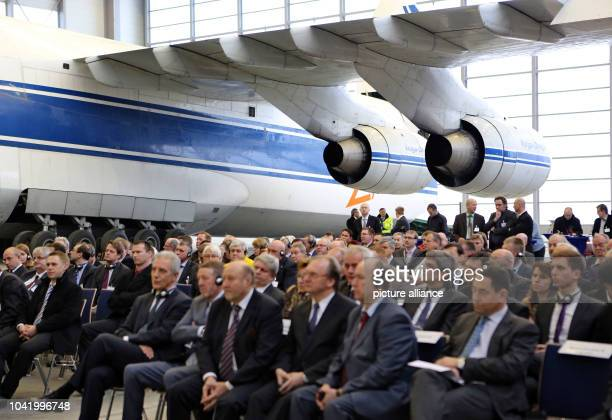 People sit in front of a Antonov 124 during the opening ceremony of the new hangar at the airport Leipzig/Halle in Schkeuditz Germany 16 January 2013...