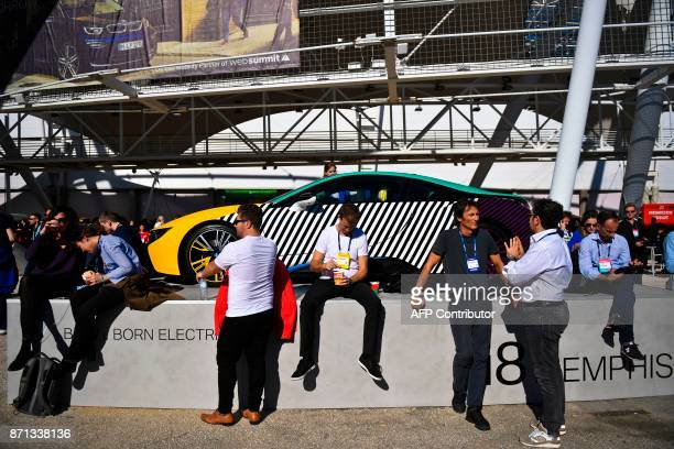 People sit in front of a BMW i8 car displayed displayed at the 2017 Web Summit in Lisbon on November 7 2017 Europe's largest tech event Web Summit is...