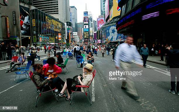 People sit in lounge chairs on Broadway in Times Square after it was converted to a pedestrian zone May 26 2009 in New York City Sections of Broadway...