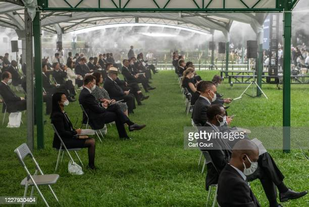 People sit in socially distanced chairs as a precaution against coronavirus as they as they attend the 75th anniversary of the Hiroshima atomic...