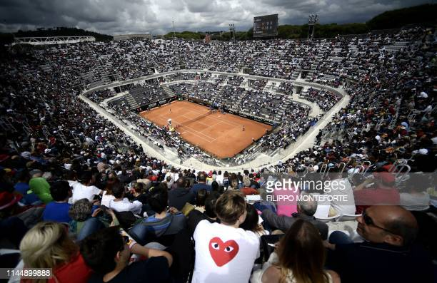 People sit in stands to watch the WTA Masters tournament final tennis match at the Foro Italico camp in Rome beetween Czech Republic's Karolina...