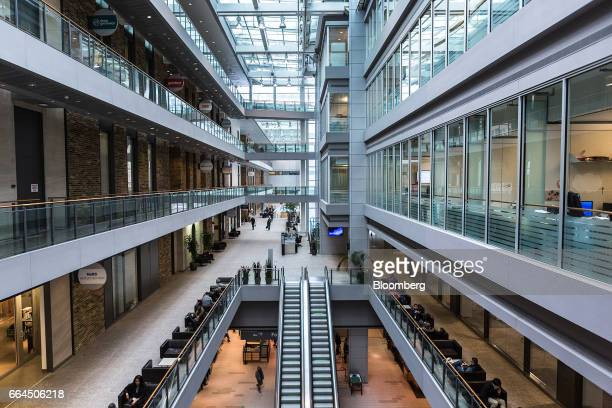 People sit in the atrium at the MaRS Discovery District building in Toronto Ontario Canada on Tuesday March 14 2017 The MaRS Discovery District is an...