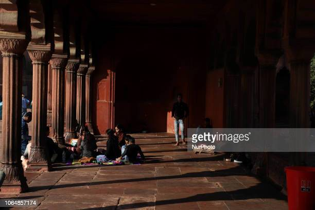 People sit in the premises of Jama Masjid in the Old Quarters of Delhi India on 24 November 2018