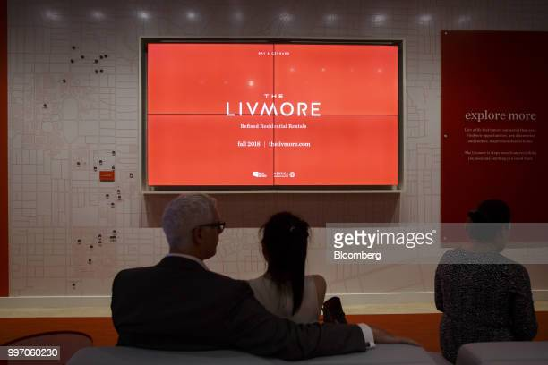 People sit in the sales center for the GWL Realty Advisors Livmore luxury apartment building in Toronto Ontario Canada on Tuesday July 10 2018...