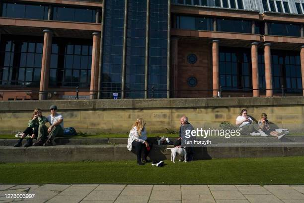People sit in the sunshine on the quayside in Newcastle on September 17 2020 in Newcastle upon Tyne England Almost two million people in northeast...